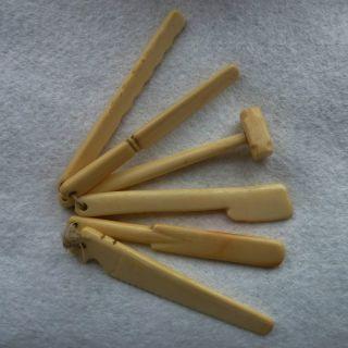 Six Figural Antique 19th Century Inuit Babies Teething Sticks.  Medium Patina. photo