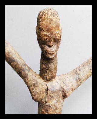 A Dramatic Lobi Thil Figure With Dynamic Lines.  Burkina Faso photo