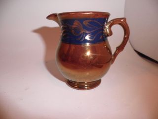 Antique Redware Pottery With Copper Luster Creamer With Stenciled Blue Decoratio photo