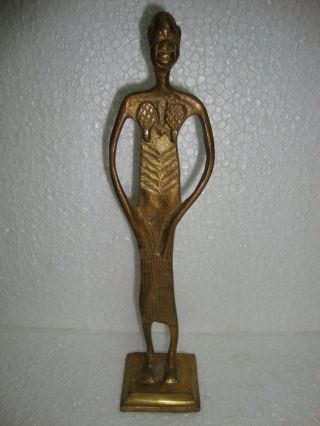 Old Heavy Brass Made African Tribal Man Standing Statue photo
