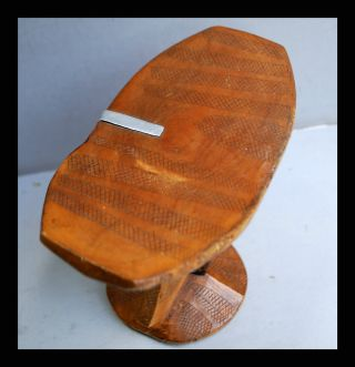 A Headrest With Indigenous Metal Repair And Engraving,  From Kenya photo