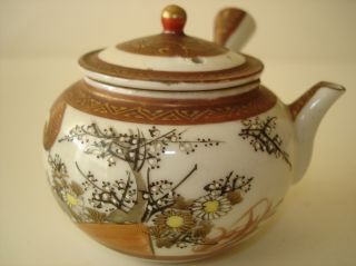 Japanese Covered Tea Pot With Flowers & Figure photo