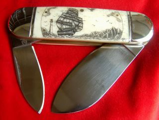 Nautical Scrimshaw Art,  Ship,  Lighthouse,  Compass,  Island,  Folding Knife/knives photo