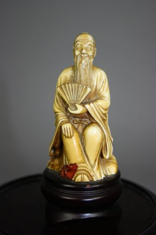 Chinese Carved Bone Seated Old Man photo