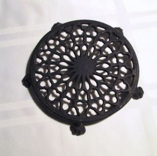 Antique Cast Iron Trivet Round Victorian Claw Foot photo