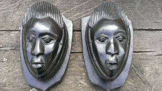Vintage African Wall Masks Pair Small Heads Ebony Heartwood Shield Shape Mounts photo