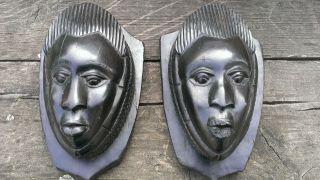 Vintage African Wall Masks Pair Small Heads Ebony Heartwood Shield Shape Mounts photo