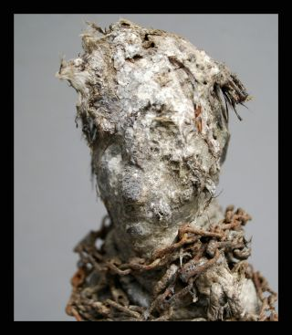 A Thickly Encrusted Power Figure With Metal Chains From Ewe Tribe Of Ghana photo