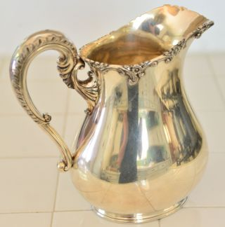 Antique Water Pitcher Meriden Co.  Silver Plate.  457 photo
