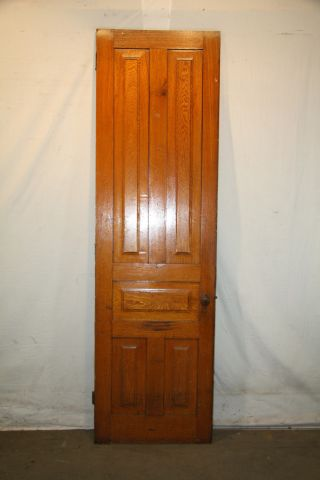 Antique Cherry Narrow And Tall Raised Panel Door With Hardware photo