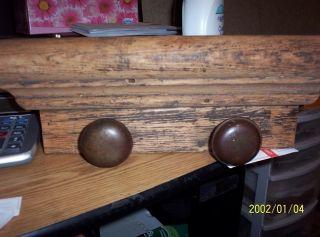 Primitive Wood Plat Door Knobs photo