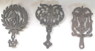 Vintage Cast Iron Trivets 3 Different,  One Wilton And Two Unmarked photo