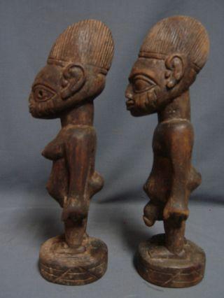 103,  Old Ibeji Male & Female Pair,  Yoruba / Santeria photo