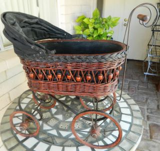 Repo Victorian/antique Style Babybuggy/pram/carriage Wood/wicker/canvas/metal photo