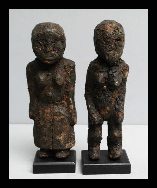 A Pair Of Deeply Encrusted Power Figures From Northern Togo photo