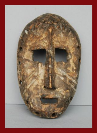 A Characterful Lega Tribe Passport Mask From The Congo photo