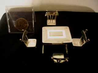 Miniature Silver Table And Chairs photo