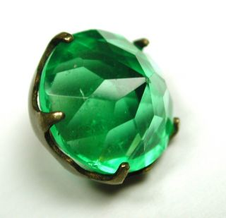 Antique Faceted Green Glass Jewel In Open Brass Setting photo