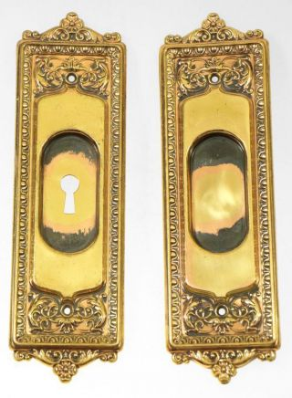 Pocket Door Hardware Set With Ornate Detail In Brass photo