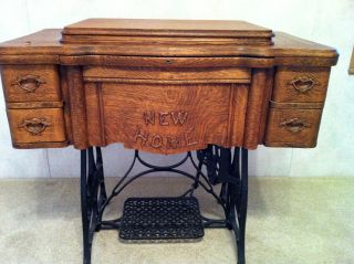 Antique New Home Treadle Sewing Machine,  1911 photo