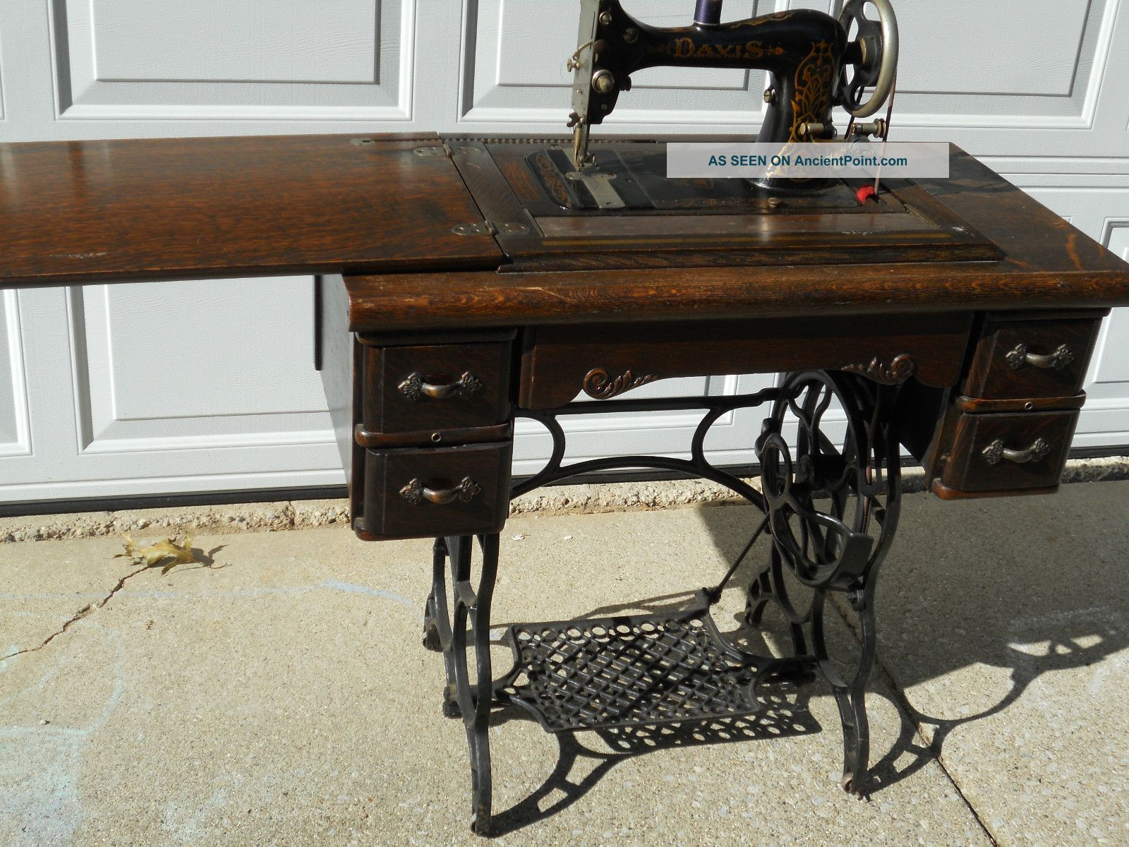 Antique davis vertical feed treadle sewing machine on cast iron base w