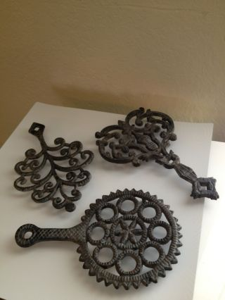 Vintage Industrial Look Ornate Cast Iron Trivet/pot/kettle Holders/hangers photo
