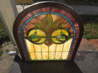 C.  1920 - 1930 Antique Stained Glass Arched Window,  Like A Morning Sunrise photo
