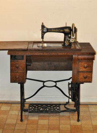 Antique Domestic Treadle Sewing Machine And Cabinet With Instructions photo