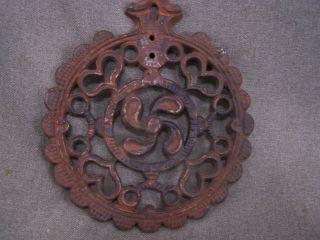Vintage Cast Iron Trivet.  6 3/4 Inches. photo