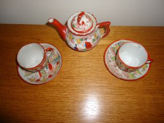Vintage Japan Geisha Girl Porcelain Teapot And Four Coffee Cups And Saucers photo