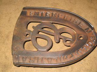 Early Cast Iron Trivet Enterprise Mfg Co.  Big E Design Coool Or What? photo