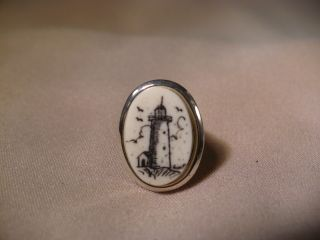 Scrimshaw Cow Bone Tie - Tac - Lighthouse photo