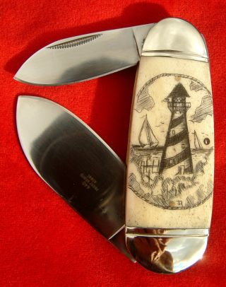 Authentic Nautical Scrimshaw Art,  Lighthouse,  Compass,  Folding Knife/knives photo