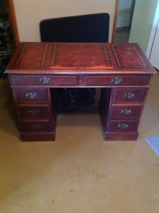 Antique Wooden Desk With A Leather Inlay photo