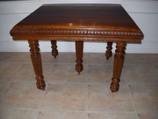 Carved Oak Dining Table & Leaves photo