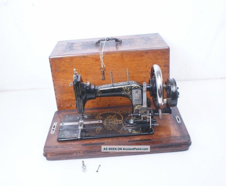 Antique German Frister & Rossmann Hand Crank Sewing Machine Sewing Machines photo