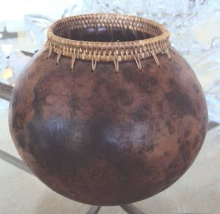Old Pottery Vase With Interweaving Top photo