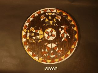 Large Wooden House Disk With Mythic Animal Motifs photo