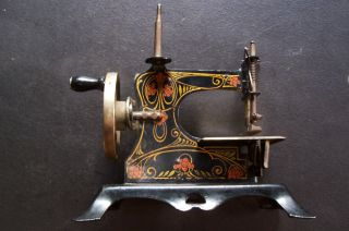 Antique Tin & Cast Iron Decorated Toy Sewing Machine - Germany photo