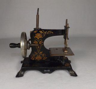 Vintage Antique German Childs Toy Sewing Machine photo