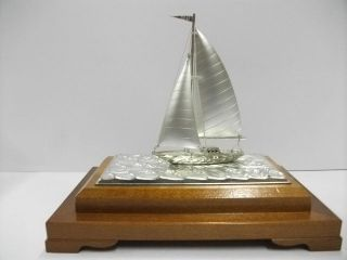 The Silver Sailboat Of The Most Wonderful Japan.  A Work Of Takehiko. photo