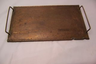 Vintage Hand Forged Copper Sad Iron Flat Trivet Brass Handle photo