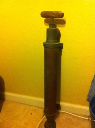 Vintage Brass Wooden Handle Hand Pump photo