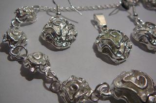 Flowers.  Silver.  Bracelet.  Earrings.  Pendant. photo