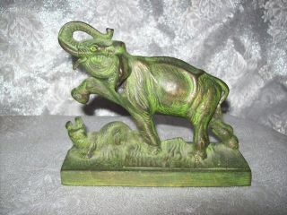 Vintage/antique Cast Iron Asian Figurine Of An Elephant Killing A Small Animal photo