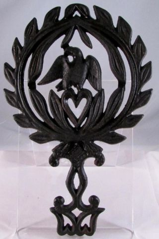 Vintage Griswold Cast Iron Eagle & Heart Footed Trivet - No.  1730 photo