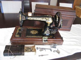 Singer Sewing Machine,  Sphinx Decal Antique Model 127,  Serial S192039 Cast Iron photo