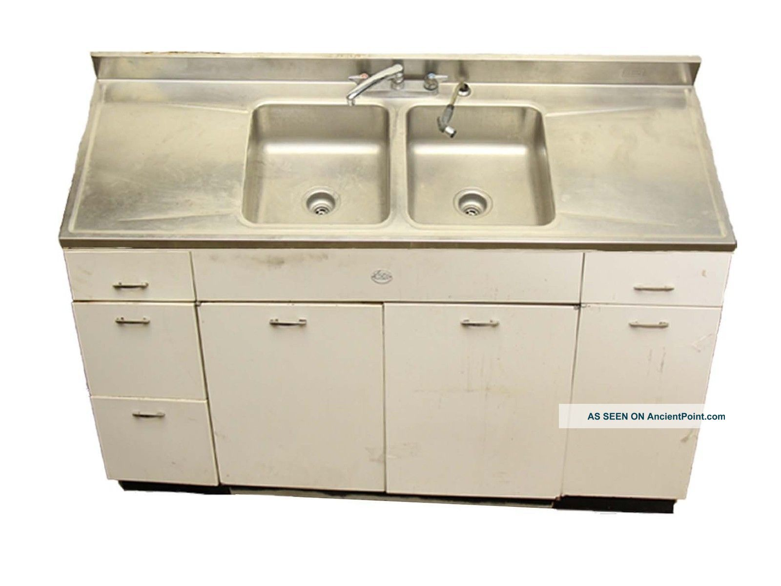 Salvaged Metal Sink And Cabinet Base Sinks photo