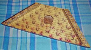 Musical Instrument 15 Stringed Brazilian Zither Or Banjo Played On The Lap photo
