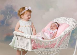 Victorian Style Wicker Baby Carriage photo